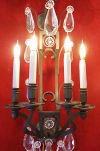 Paire d'importantes appliques en bronze pâtiné et pampilles du XIXème siècle, 4 lumières.