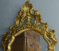 Miroir en bois sculpté doré de style Louis XV 19è siècle