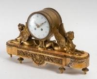 Pendule Napoléon III en bronze doré et marbre