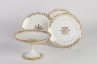 Douze assiettes et un présentoir de Sèvres 1883