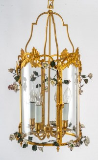 A Louis XV style lantern decorated with porcelain flowers.