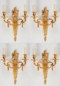 Suite de quatre appliques de style Louis XVI.