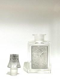 """Flacon """"L'Effleurt"""" pour Coty verre blanc patiné gris de René LALIQUE"""
