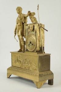 Empire clock from the 19th Century in Gold Gilt bronze.