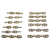 Hermès, 12 porte-couteaux en métal, XXème