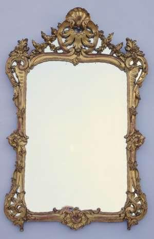 Miroir Louis XV à parecloses de bois doré