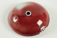 Paul Badié - Vase en porcelaine à relief géométrique, couverte rouge de cuivre.