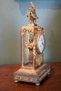 Pendule cage de style Louis XVI, XIX ème siècle