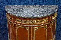 A Louis XVI style demi-lune commode.