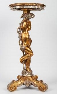 Une sellette Amour en bois doré et argenté. Fin XIXème - Début XXème.