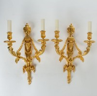 A Louis XVI style pair of wall lights.