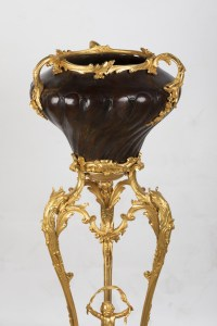A French 19th Century Guilt and Patinated Bronze Jardinière on Stand.