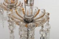 Un ensemble de trois candélabres Baccarat à trois bras de lumière
