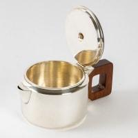 Service à thé et à café égoïste argent massif et palissandre de Jean E. PUIFORCAT