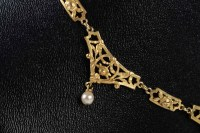 Collier en or 18 carats et perles
