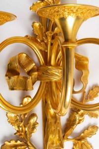 Suite de quatre importantes appliques de style Louis XVI.