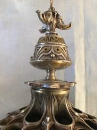 Porte cigares, boite d'allumettes et lampe à huile, en bronze argenté, à motifs égyptiens, monogrammé E.L. Réf: 299