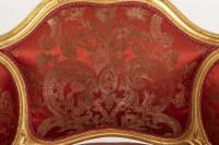 Paire de bergères basses de style Louis XV en bois doré, vers 1880