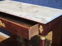 A 1st Empire period (1804 - 1815) console table.