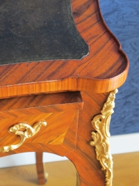 A Napoleon III period (1848 - 1870) desk in Louis XV style.