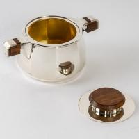 Service à thé et à café à pans coupés argent massif et palissandre de Jean E. PUIFORCAT