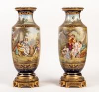 Paire de vases bleu de sèvres. Décors à la Wateau (signés). XIXème