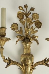 Paire d'appliques de style Louis XVI en bronze doré.