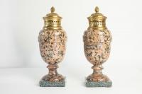 A pair of period Louis XVI rose granite urns with gold gilt bronze. 18th Century. C.1780.