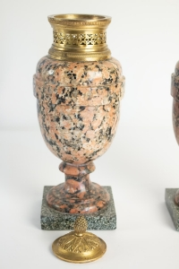 A pair of period Louis XVI rose granite urns with gold gilt bronze. 18th Century. C.1780.