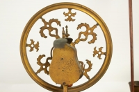 Period Louis XV spinning wheel in rose wood, violet wood, and gold gilt.