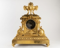 A French 19th Century Ormulu Mantel Clock by Maison Marquis.