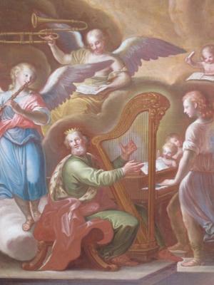 The King David playing the harp.