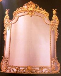 Exceptionnel miroir de boiserie d'époque Régence en bois sculpté et doré